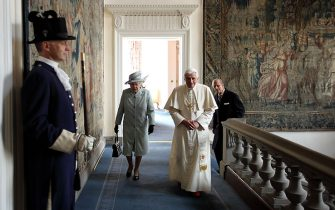 EDINBURGH, UNITED KINGDOM - SEPTEMBER 16:  Queen Elizabeth II and Prince Philip, Duke of Edinburgh walk with Pope Benedict XVI to the Morning Drawing Room in the Palace of Holyroodhouse, the Queen's official residence in Scotland, on September 16, 2010 in Edinburgh, Scotland. Pope Benedict XVI is conducting the first state visit to the UK by a Pontiff. During the four day visit Pope Benedict will celebrate mass, conduct a prayer vigil as well as beatify Cardinal Newman at an open air mass in Cofton Park. His Holiness will meet The Queen as well as political and religious representatives.  (Photo by Dan Kitwood/Getty Images)