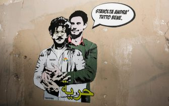 """Last night in Rome, on the wall surrounding Villa Ada, a few steps from the Embassy of Egypt, appeared a work of the Street Artist Laika that portrays Giulio Regeni embracing the student arrested in Egypt Zaki, wearing an inmate uniform. In front of the two figures is the word """"Freedom"""" written in Arabic. In the opera, Regeni reassures Zaki, telling him: """"This time everything will be fine"""", Rome, Italy, 11 February 2020. The murder of Giulio Regeni was committed in Egypt between January and February 2016. Regeni was an Italian student at the University of Cambridge who was abducted on 25 January 2016, the fifth anniversary of the Tahrir Square protests. He was found lifeless on 03 February in the vicinity of an Egyptian secret service prison. ANSA / Alessandra Magliaro"""