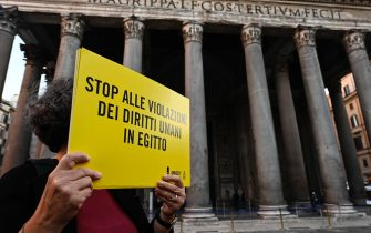 Demonstrators with signs stage a silent flashmob to demand the release of the researcher Patrick Zaki from jail in Egypt, Rome, Italy, 23 February 2020. ANSA/RICCARDO ANTIMIANI