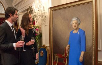 WELLINGTON, NEW ZEALAND - APRIL 10:  (NO UK SALES FOR 28 DAYS) Catherine, Duchess of Cambridge inspects a portrait of Queen Elizabeth II, painted by New Zealand artist Nick Cuthell and unveiled at a state reception at Government House on April 10, 2014 in Wellington, New Zealand.on April 10, 2014 in Wellington, New Zealand. The Duke and Duchess of Cambridge are on a three-week tour of Australia and New Zealand, the first official trip overseas with their son, Prince George of Cambridge.  (Photo by Pool/Samir Hussein/WireImage)