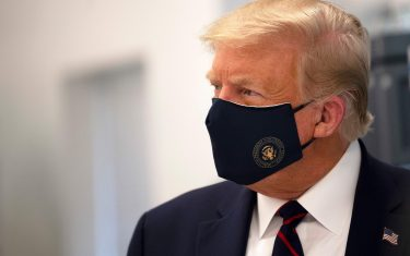 TOPSHOT - US President Donald Trump wears a mask as he tours a lab where they are making components for a potential vaccine at the Bioprocess Innovation Center at Fujifilm Diosynth Biotechnologies in Morrisville, North Carolina on July 27, 2020. (Photo by JIM WATSON / AFP) (Photo by JIM WATSON/AFP via Getty Images)