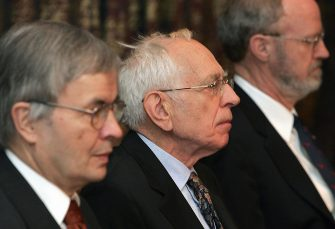 """Stockholm, SWEDEN:  Nobel Prize winner in Chemistry 2005, French Yves Chauvin (C) is seated between German Theodor W. H?nsch (Nobel Physics winner) and US Robert H. Grubbs during a press conference in Stockholm, 07 December 2005. Chauvin will together with US Richard R. Schrock and fellowcountryman Robert H. Grubbs, on 10 December be awarded The Nobel Prize in Chemistry 2005 """"for the development of the metathesis method in organic synthesis"""".              AFP PHOTO    SVEN NACKSTRAND  (Photo credit should read SVEN NACKSTRAND/AFP via Getty Images)"""
