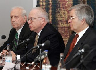 """Stockholm, SWEDEN:  Nobel Prize winner in Physics, US Roy J. Glauber (L), US John L. Hall (C) and German Theodor W. Hansch (R), give a joint press conference in Stockholm, Sweden, 07 December 2005. They will be awarded 10 December with The Nobel Prize in Chemistry 2005 : Glauber """"for his contribution to the quantum theory of optical coherence"""", Hall and Hansch, """"for their contributions to the development of laser-based precision spectroscopy, including the optical frequency comb technique"""".           AFP PHOTO - SVEN NACKSTRAND  (Photo credit should read SVEN NACKSTRAND/AFP via Getty Images)"""