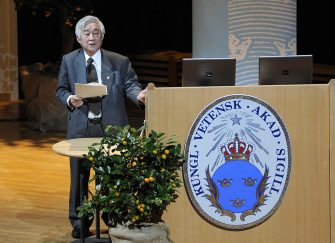 One of the Japanese 2008 Nobel physics prize laureates, Toshihide Maskawa, lectures at Stockholm University on December 8, 2008. The physics Nobel prize was also awarded to Makoto Kobayashi and Yoichiro Nambu.  AFP PHOTO / OLIVIER MORIN (Photo credit should read OLIVIER MORIN/AFP via Getty Images)