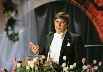 Nobel Physics laureate Andre Geim talks at the Nobel banquet in the Stockholm City Hall, on December 10, 2010.The formal event, held as tradition dictates on the anniversary of the death of prize founder Alfred Nobel in 1896, took place at Stockholm's Concert Hall which was decked out in 20,000 pink, red and purple flowers for the occasion.AFP PHOTO HENRIK MONTGOMERY / SCANPIX (Photo by HENRIK MONTGOMERY / NTB SCANPIX / AFP)        (Photo credit should read HENRIK MONTGOMERY/AFP via Getty Images)