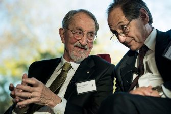 Dr. Martin Karplus (L), 2013 Nobel Laureate for Chemistry, confers with Dr. Michael Levitt (R), 2013 Nobel Laureate for Chemistry, during a Nobel Laureate Symposium at the Embassy of Sweden November 19, 2013 in Washington, DC. Nine people from the United States were honored this year with the Nobel Prize in the fields of medicine, chemistry and economic sciences. AFP PHOTO/Brendan SMIALOWSKI        (Photo credit should read BRENDAN SMIALOWSKI/AFP via Getty Images)
