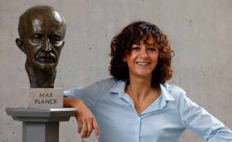 French researcher in Microbiology, Genetics and Biochemistry Emmanuelle Charpentier poses for photographers next to a bust of Max Planck in Berlin, on October 7, 2020. - Emmanuelle Charpentier of France and Jennifer Doudna of the US on October 7, 2020 won the Nobel Chemistry Prize for research into the gene-editing technique known as the CRISPR-Cas9 DNA snipping tool. (Photo by Odd ANDERSEN / AFP) (Photo by ODD ANDERSEN/AFP via Getty Images)