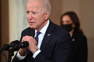 TOPSHOT - US President Joe Biden gestures as he delivers remarks on the guilty verdict against former policeman Derek Chauvin at the White House in Washington, DC, on April 20, 2021. - Derek Chauvin, a white former Minneapolis police officer, was convicted on April 20 of murdering African-American George Floyd after a racially charged trial that was seen as a pivotal test of police accountability in the United States. (Photo by Brendan SMIALOWSKI / AFP) (Photo by BRENDAN SMIALOWSKI/AFP via Getty Images)