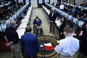 US President Joe Biden and Texas Governor Greg Abbott (C L) listen to officials at the Harris County Emergency Operations Center in Houston, Texas on  February 26, 2021. - Biden is visiting Houston, Texas following severe winter storms which left much of the state without electricity for days. (Photo by MANDEL NGAN / AFP) (Photo by MANDEL NGAN/AFP via Getty Images)