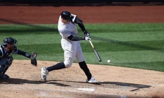 NEW YORK, NEW YORK - APRIL 01:  Aaron Judge #99 of the New York Yankees hits into a bases loaded, inning ending double play in the seventh inning against the Toronto Blue Jays during Opening Day at Yankee Stadium on April 01, 2021 in New York City. (Photo by Al Bello/Getty Images)