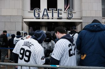 NEW YORK CITY - APRIL 01: People line up to enter Yankee Stadium in the Bronx for the Opening Day of baseball season on April 01, 2021 in New York City. Yankee Stadium, also one of New York's largest mass Covid-19 vaccination sites, is celebrating Opening Day Thursday afternoon when they face the Blue Jays. The stadium is operating at only 20% capacity, which means 10,850 tickets will be sold per game. (Photo by Spencer Platt/Getty Images)