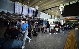 Travelers walk across a terminal at Rome's Fiumicino airport on June 3, 2020, as airports and borders reopen for tourists and residents free to travel across the country, within the COVID-19 infection, caused by the novel coronavirus. (Photo by Filippo MONTEFORTE / AFP) (Photo by FILIPPO MONTEFORTE/AFP via Getty Images)