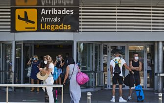 IBIZA, SPAIN - JULY 28: Newly arrived tourists in the area outside Ibiza airport on July 28, 2020 in Ibiza, Spain. The United Kingdom, whose citizens comprise the largest share of foreign tourists in Spain, added Ibiza and other Spanish islands to its advice against non-essential travel to the country, citing a rise in coronavirus cases. The change follows the UK's decision to reimpose a 14-day isolation period for travelers returning from Spain. (Photo by Andres Iglesias/Getty Images)