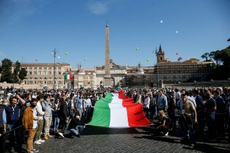 A big Italian flag (the Tricolore) on the occasion of the event organized by the center-right on the occasion of the Italy's Republic Day in the centre of Rome, Italy, 02 June 2020. ANSA/FABIO FRUSTACI