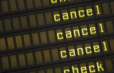 BERLIN, GERMANY - SEPTEMBER 04:  A departures board shows cancellations after Lufthansa flights were cancelled during a strike by Lufthansa cabin crew at Tegel Airport on September 4, 2012 in Berlin, Germany. Lufthansa cabin crew members are striking at Frankfurt and Berlin airports today following the breakdown of talks between the UFO labour union and Lufthansa management over a pay increase and other cabin crew demands.  (Photo by Sean Gallup/Getty Images)