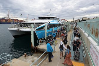 PERTH, AUSTRALIA - JUNE 06: Passengers wait to board a Sealink ferry to Rottnest Island on June 06, 2020 in Fremantle, Australia. Restrictions continue to ease around Australia in response to the country's declining COVID-19 infection rate. Phase three of eased coronavirus restrictions have come into effect across Western Australia as of midnight 6 June 2020, with the majority of businesses affected by the lockdown permitted to reopen,  including gyms, theatres, beauty services and cinemas. Indoor and outdoor gatherings of up to 100 people are also now permitted and up to 300 people will be allowed in some venues subject to spacing rules, while food businesses and licensed premises can operate with seated service. Full contact sport and training is now permitted while playgrounds, skate parks and outdoor gym equipment can be used. Most intrastate travel restrictions have been lifted and Rottnest Island has reopened to visitors again. (Photo by Paul Kane/Getty Images)