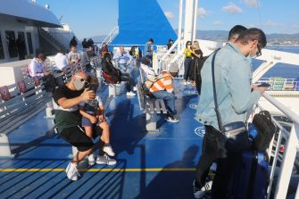 VILLA SAN GIOVANNI, ITALY - JUNE 3: Passengers are seen on board the ferry that connects Calabria and Sicily from Villa San Giovanni to Messina on June 3, 2020 in Villa San Giovanni, Italy. Italy has reopened its borders and ended travel restrictions between regions, hoping to encourage tourists back in time for the summer. The country was the first in Europe hit hard by the outbreak and has recorded more than 33,000 deaths. (Photo by Marco Di Lauro/Getty Images)