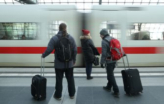 BERLIN, GERMANY - JANUARY 16:  Travellers pulling suitcases prepare to board an arriving ICE high-speed train of German state rail carrier Deutsche Bahn at Hauptbahnhof main railway station on January 16, 2017 in Berlin, Germany. According to a recent media report 79% of high-speed Deutsche Bahn trains were on time in 2016, the highest rate since 2012.  (Photo by Sean Gallup/Getty Images)