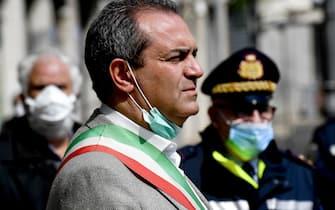Luigi de Magistris  mayor of Naples  stand in silence to honor the country's dead due to coronavirus disease, at Municipio square in Naples, Italy,  31 March, 2020.ANSA / CIRO FUSCO