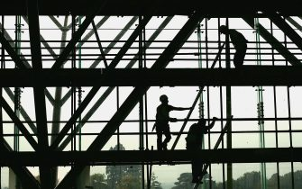 ASCOT, ENGLAND - OCTOBER 11: Construction workers continue redevelopment work at Ascot Racecourse with the building of a new grandstand on October 11, 2005 at Ascot, England. The Berkshire track is due to reopen next June in time for the annual Royal Meeting. (Photo by Julian Herbert/Getty Images)