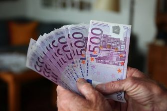 MUNICH, GERMANY - MAY 09:  Businessman with 500 Euro banknotes. on May 09, 2010 in Munich, Germany. (Photo by EyesWideOpen/Getty Images)