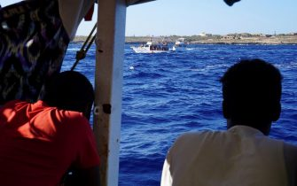Migrants of the Open Arms rescue ship on board after 18 days at sea during the visit of Lampedusa's Mayor Salvatore Martello off Lampedusa, Italy, 19 August 2019. The Spanish aid organization Proactiva Open Arms raised the possibility to transfer the migrants to Catania, Sicily, and then charter them to Spain, whose government offered to receive them.  ANSA/Francisco Gentico