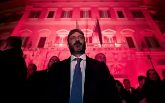 Italian Lower House Speaker Roberto Fico in front of the facade of Palazzo Montecitorio, seat of the Italian Chamber of Deputies, illuminated in red on the occasion of the International Day for the Elimination of Violence against Women, Rome, 25 November 2019.