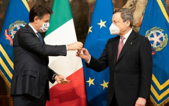 Italy's new Prime Minister Mario Draghi (R) receives a small bell by outgoing Prime Minister Giuseppe Conte to mark the government handover and to open the first council of Ministers at Chigi Palace in Rome, Italy, 13 February 2021. ANSA/FILIPPO ATTILI/US PALAZZO CHIGI +++ NO SALES, EDITORIAL USE ONLY +++