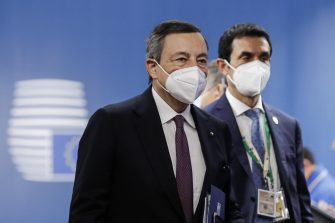 epa09226168 Italian Prime Minister Mario Draghi (L) arrives at the second day of a special EU summit in Brussels, Belgium, 25 May 2021. EU leaders will focus on the COVID-19 pandemic and the climate change on 25 May.  EPA/OLIVIER HOSLET / POOL