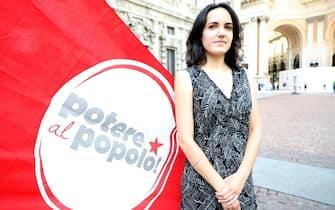 La candidato a  sindaco di Milano per Potere al Popolo Bianca Tedone posa per una foto in piazza della Scala,   Milano 6 Luglio 2021.ANSA /MATTEO BAZZI