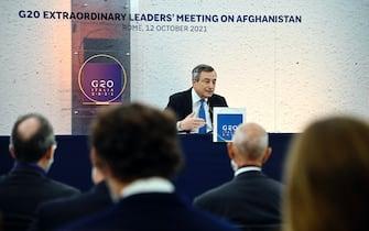 Giornalisti alla conferenza stampa del premier Draghi dopo il G20 sull'Afghanistan