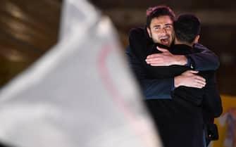 Italian 5-Star Movement's candidate for the post of the Prime Minister, Luigi Di Maio, embraces Alessandro Di Battista (L) during the closing of the electoral campaign of the M5S in Rome, Italy, 02 March 2018. ANSA/ETTORE FERRARI