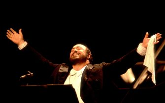Italian tenor Luciano Pavarotti performs onstage at the Poplar Creek Music Theater, Hoffman Estates, Illinois, August 13, 1984. (Photo by Paul Natkin/Getty Images)