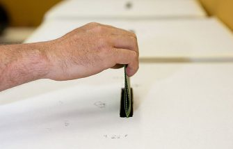 ROME, ITALY - JUNE 13:   A man casts his ballot as he votes in the Italian referendum on nuclear power in a polling station, on June 13, 2011 in Rome, Italy. The country has been committed to a referendum on June 12-13, 2011 on the re-introduction of nuclear power, on the privatization of water and on 'legittimo impedimento', a law that would grant immunity to Prime Minister Silvio Berlusconi from many ongoing trials accusing him of various crimes.  (Photo by Giorgio Cosulich/Getty Images)