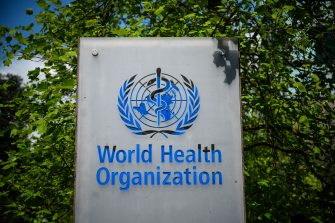 This picture taken on April 24, 2020 shows a sign of the World Health Organization (WHO) in Geneva next to their headquarters, amid the COVID-19 outbreak, caused by the novel coronavirus. (Photo by Fabrice COFFRINI / AFP) (Photo by FABRICE COFFRINI/AFP via Getty Images)