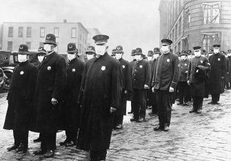 """IMAGES OF THE FLU PANDEMIA IN 1918. © THE PHOTO ONE. CODE: SI. The images of people wearing face mask to protect against the pandemia of coronavirus Covid-19 or big spaces conditioned like hospitals and crowded of patients are not new in 2020. A century ago, in 1918, immediately after the First World War, that happened with the so called """" SPANISH FLU """". That pandemia infected 50 million people between January 1918 and December 1920 of a population of 1600 million people in the World. Just to compare, in the Big War died 16 million people. Despite was called """"Spanish Flu"""" it was originated in France after the war, and even is said that was brought by the American soldiers who came to fight in Europe. ***PHOTOS: Images of the city, masked population, crowded conditioned spaces conditioned as hospitals to fight against the infectious disease with sick people,  and local paper cover page in the city of Santander, Northern Spain, in 1918. (SI. / IPA/Fotogramma, . - 2020-03-31) p.s. la foto e' utilizzabile nel rispetto del contesto in cui e' stata scattata, e senza intento diffamatorio del decoro delle persone rappresentate"""