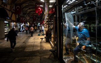 ISTANBUL, TURKEY - JUNE 01: A store owners cleans his shops window in Istanbul's famous Grand Bazaar after it reopened after being shut down for weeks due to the spread of the coronavirus on June 01, 2020 in Istanbul, Turkey. As infection rates of the coronavirus continue to drop and after more than a month of weekend lockdowns, Turkey has begun reopening procedures, allowing bars, restaurants and cafes to open under new restrictions for the first time since March 17. Limited domestic flights have restarted and the stay-at-home curfew for citizens under 20 and over 65 has been eased.   (Photo by Chris McGrath/Getty Images)