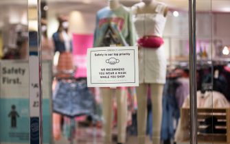 MINNEAPOLIS, MN - JUNE 10: Signage hung on a window asks customers to wear a mask inside a store at the Mall of America on June 10, 2020 in Minneapolis, Minnesota. Today marks the first day the destination mall has been open since March due to coronavirus pandemic restrictions. (Photo by Stephen Maturen/Getty Images)