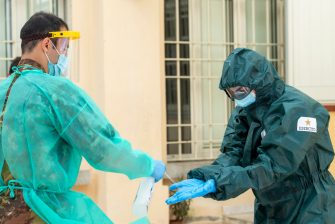 TEMPIO PAUSANIA, ITALY - MAY 21: The army doctor is disinfected after testing for coronavirus (COVID-19) inside the health facility on May 21, 2020 in Tempio Pausania, Italy. Italy has eased the lockdown due to the Covid-19 pandemic and many businesses are allowed to reopen after a full disinfection. (Photo by Emanuele Perrone/Getty Images)
