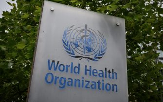 This picture taken on May 12, 2020, shows a sign of the World Health Organization (WHO) in Geneva next to their headquarters, amid the COVID-19 outbreak, caused by the novel coronavirus. (Photo by Fabrice COFFRINI / AFP) (Photo by FABRICE COFFRINI/AFP via Getty Images)