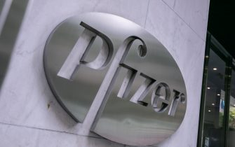 NEW YORK, NY - JULY 22: Pfizer Inc. signage is seen on July 22, 2020 in New York City. Pfizer and German biotechnology firm BioNTech have agreed to supply the U.S. government with 100 million doses of coronavirus vaccine under a $1.95 billion deal. (Photo by Jeenah Moon/Getty Images)