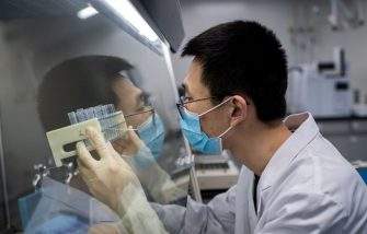 TOPSHOT - In this picture taken on April 29, 2020, an engineer works at the Quality Control Laboratory on an experimental vaccine for the COVID-19 coronavirus at the Sinovac Biotech facilities in Beijing. - Sinovac Biotech, which is conducting one of the four clinical trials that have been authorised in China, has claimed great progress in its research and promising results among monkeys. (Photo by NICOLAS ASFOURI / AFP) / TO GO WITH Health-virus-China-vaccine,FOCUS by Patrick Baert (Photo by NICOLAS ASFOURI/AFP via Getty Images)