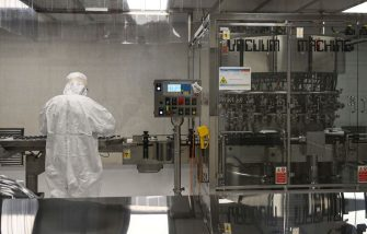 A laboratory technician takes part in filling and packaging tests for the large-scale production and supply of the University of Oxfords COVID-19 vaccine candidate, AZD1222, conducted on a high-performance aseptic vial filling line on September 11, 2020 at the Italian biologics manufacturing facility of multinational corporation Catalent in Anagni, southeast of Rome, during the COVID-19 infection, caused by the novel coronavirus. - Catalent Biologics manufacturing facility in Anagni, Italy will serve as the launch facility for the large-scale production and supply of the University of Oxfords Covid-19 vaccine candidate, AZD1222, providing large-scale vial filling and packaging to British-Swedish multinational pharmaceutical and biopharmaceutical company AstraZeneca. (Photo by Vincenzo PINTO / AFP) (Photo by VINCENZO PINTO/AFP via Getty Images)