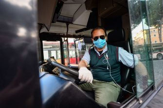 ROME, ITALY - APRIL 30: A man wearing a protective mask drives a public bus in Piazza Venezia area empty of tourists during the Coronavirus (COVID-19) pandemic, on April 30, 2020 in Rome, Italy. Italy will remain on lockdown to stem the transmission of the Coronavirus (Covid-19), slowly easing restrictions. (Photo by Silvia Lore/Getty Images)