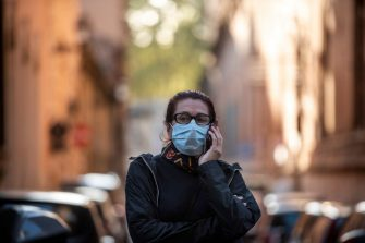 ROME, ITALY - OCTOBER 07: A woman talks on the phone while wearing a protective mask at Via del Corso amid Covid-19 pandemic, on October 07, 2020 in Rome, Italy. Today Italian Prime Minister Giuseppe Conte set an order to make the wearing of face masks in outdoor spaces mandatory due to the increase of Covid-19 cases in Italy. Today there has been an increase in new COVID-19 cases in Italy with the number rising to 3678 for the first time in months. (Photo by Antonio Masiello/Getty Images)