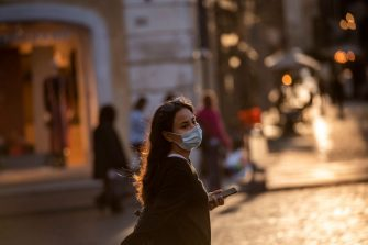 ROME, ITALY - OCTOBER 07: A woman wearing a protective mask walks at Piazza di Spagna amid Covid-19 pandemic, on October 07, 2020 in Rome, Italy. Today Italian Prime Minister Giuseppe Conte set an order to make the wearing of face masks in outdoor spaces mandatory due to the increase of Covid-19 cases in Italy. Today there has been an increase in new COVID-19 cases in Italy with the number rising to 3678 for the first time in months. (Photo by Antonio Masiello/Getty Images)