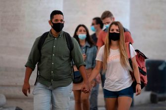 People wearing protective face masks walk in St. Peter's Square at the Vatican  on 8 October 2020. - The authorities of the Italian capital Rome have ordered to always wear face protection outdoors, in an attempt to counter the spread of coronavirus disease. (Photo by Tiziana FABI / AFP) (Photo by TIZIANA FABI/AFP via Getty Images)
