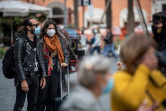 ROME, ITALY - OCTOBER 02: People wearing protective masks walk around the Piazza di Spagna amid Covid-19 pandemic, on October 02, 2020 in Rome, Italy. The Lazio region President Nicola Zingaretti set an order obliging people to wear face masks in public including outdoors due to the increase of Covid-19 cases in the Lazio region. (Photo by Antonio Masiello/Getty Images)