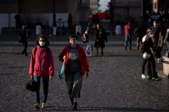 ROME, ITALY - OCTOBER 07: People wearing protective masks walk at Piazza del Popolo amid Covid-19 pandemic, on October 07, 2020 in Rome, Italy. Today Italian Prime Minister Giuseppe Conte set an order to make the wearing of face masks in outdoor spaces mandatory due to the increase of Covid-19 cases in Italy. Today there has been an increase in new COVID-19 cases in Italy with the number rising to 3678 for the first time in months. (Photo by Antonio Masiello/Getty Images)