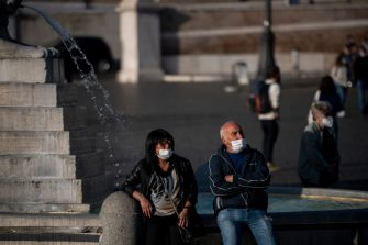 ROME, ITALY - OCTOBER 07: People wearing protective masks sit in a fountain at Piazza del Popolo amid Covid-19 pandemic, on October 07, 2020 in Rome, Italy. Today Italian Prime Minister Giuseppe Conte set an order to make the wearing of face masks in outdoor spaces mandatory due to the increase of Covid-19 cases in Italy. Today there has been an increase in new COVID-19 cases in Italy with the number rising to 3678 for the first time in months. (Photo by Antonio Masiello/Getty Images)
